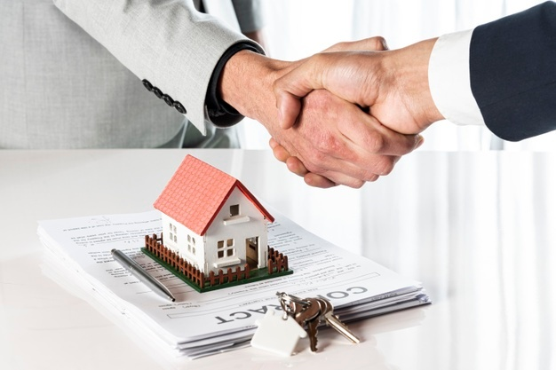 people shaking hands over a toy model house 23 2148301743